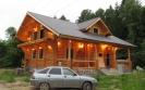 Дом из оцилиндрованного бревна диаметром 240 мм